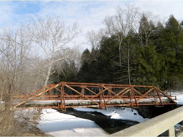 Old bridge running over the Flat brook