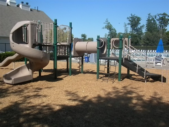 Playgrounds are set throughout The Hills communities; this is next to Rec Center and pools