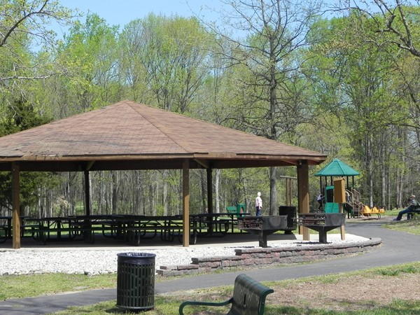 Washington Lake Park visitors enjoy the covered pavilion with grills and a third playground area