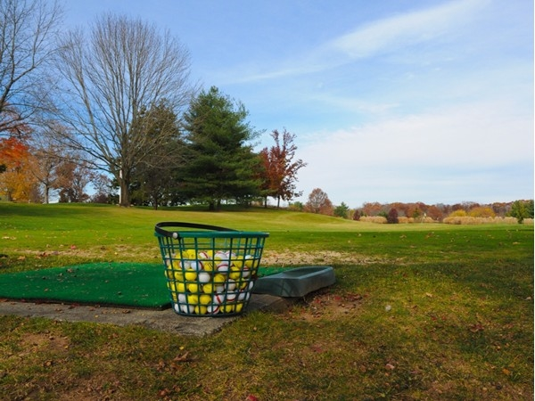 A basket of golf balls sits on the tee at Brooklake Country Club
