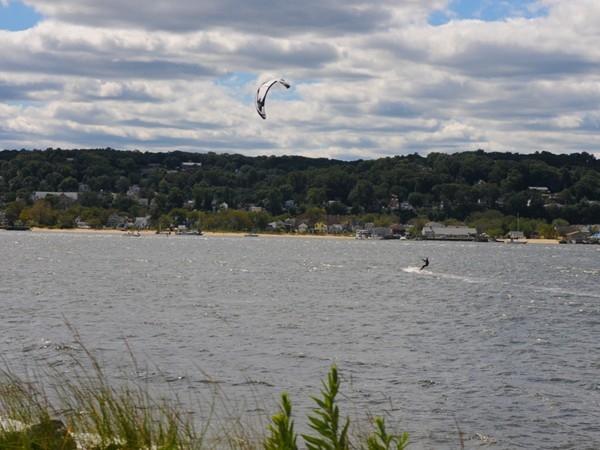 Wind surfers enjoy the water in Sandy Hook