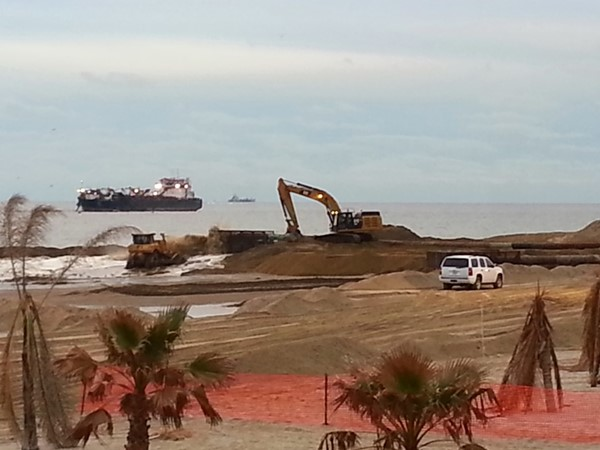 Sand being pumped onto the beach behind the Ocean Place Resort as part of the beach replenishment