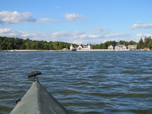 Kayak view approaching Lake Mohawk clubhouse and boardwalk in early Fall