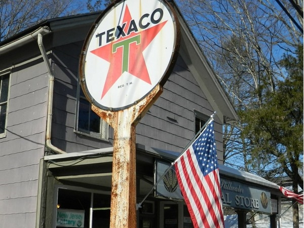 The flag fly's above a old Fire Chief gas pump at Old Stillwater General Store