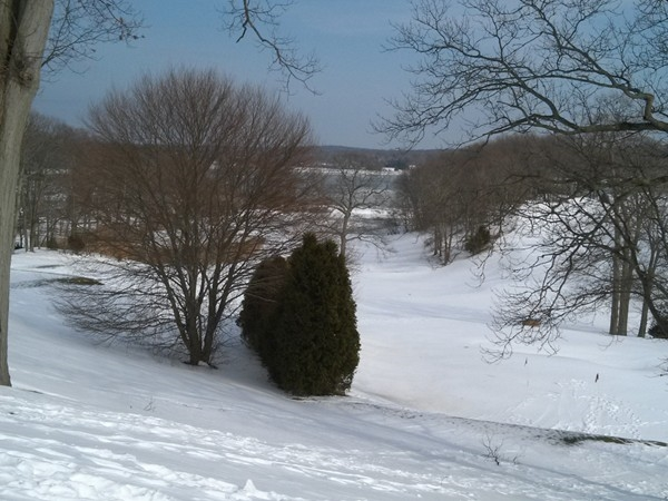 A winter view of Stony Brook Harbor from a lofty hillttop