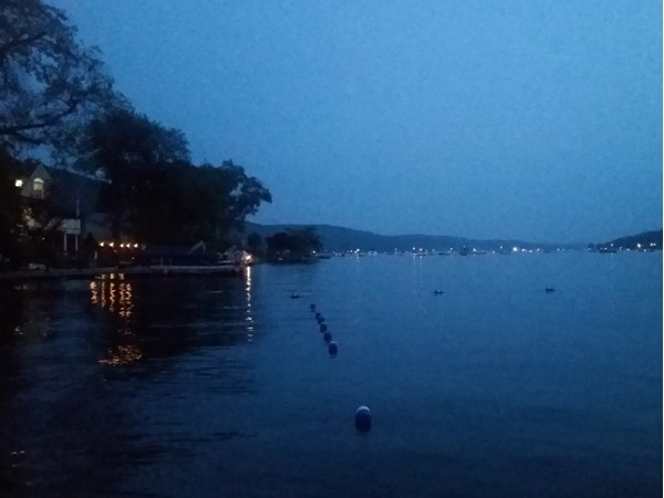 Waiting for the fireworks to start, facing a beautiful view of the lake and the boat audience