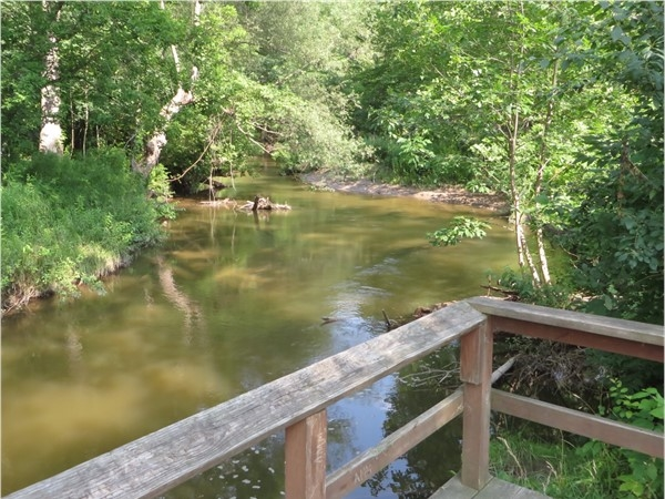 Beautiful view of the creek flowing through Powder Mill Park in Perinton