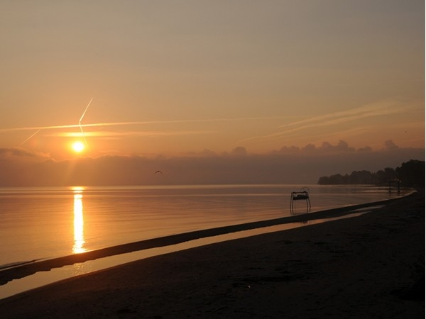 It's rare for Lake Ontario to be completely calm, but it sure makes for a special sunrise