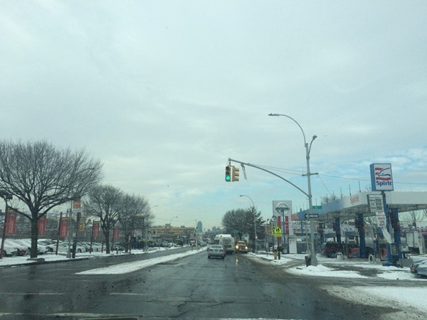 After receiving light snow in Jackson Heights. It looks better when it's falling