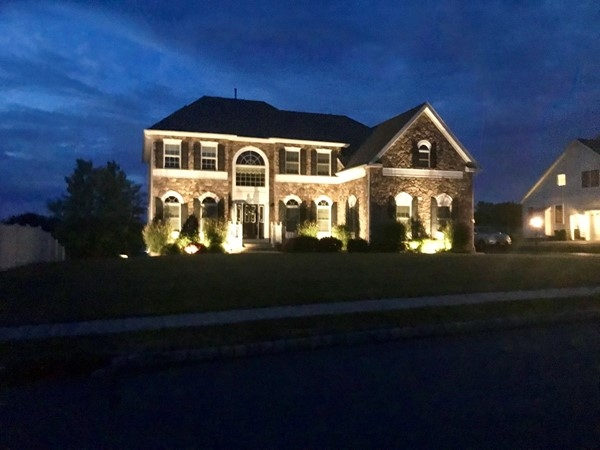 There is just something magical about outdoor lighting on a stone faced home