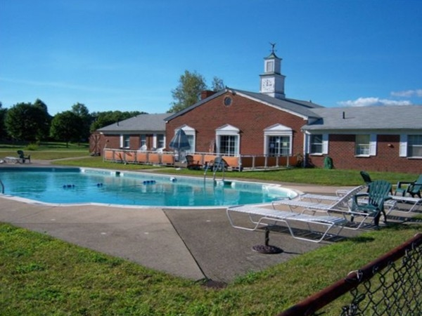 Community pool and clubhouse at Weathervane Condos