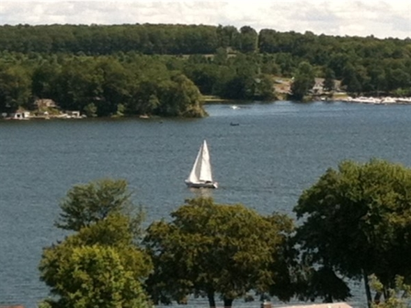 View of a sailboat on Sodus Bay from Shaker Heights