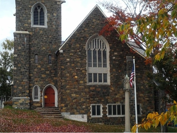 This beautiful Adirondack Community Church is one of the many places to worship in Lake Placid