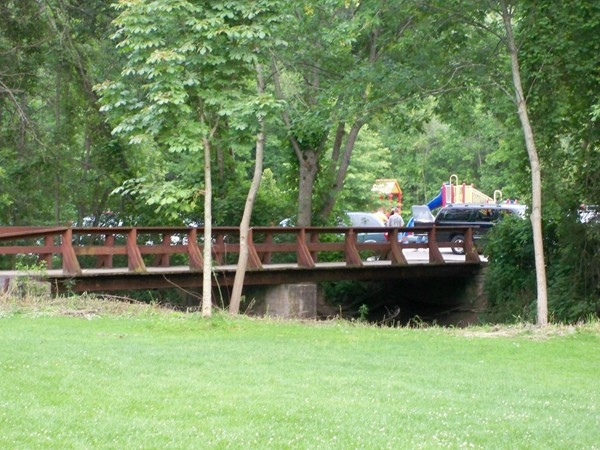 Pedestrian bridge from the parking lot to the picnic pavilion in Powder Mill Park in Mendon
