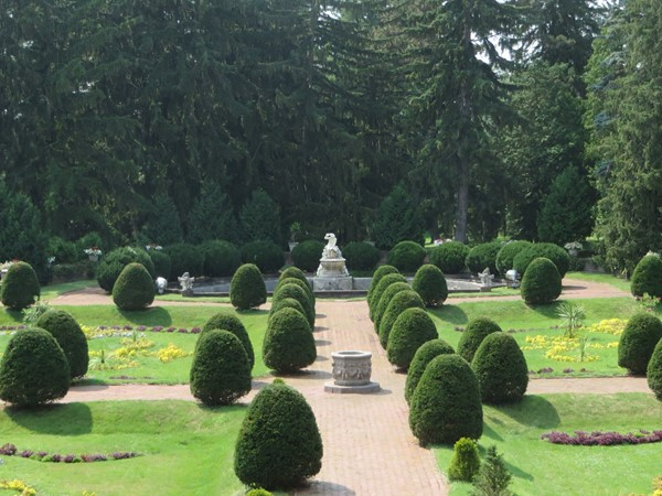 View of the formal gardens at Sonnenberg Gardens from the patio