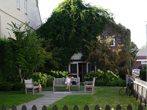 Take a moment to rest before continuing shopping on the Main Street of East Hampton Village