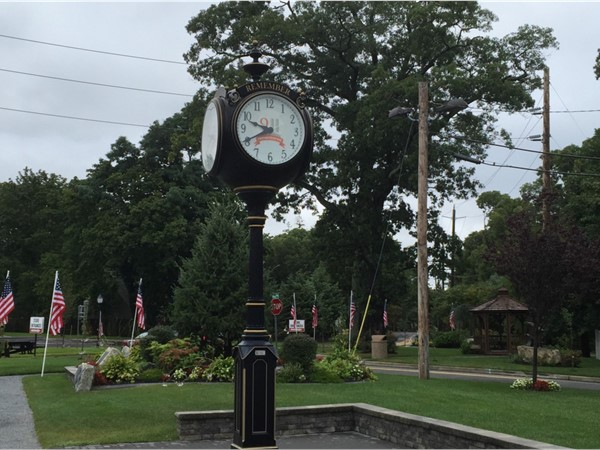 Clock with formal gardens in the background
