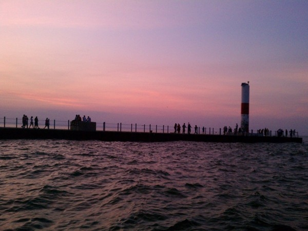 Historic lighthouse at the end of Charlotte Pier on Lake Ontario