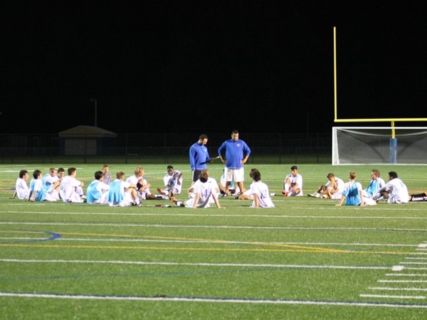 Webster Schroeder Warriors sitting on the new turf at the stadium