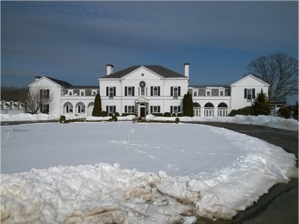 The stately Nissequogue Golf Clubhouse after a snow storm
