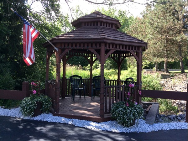 Relax in the community gazebo over looking the woods