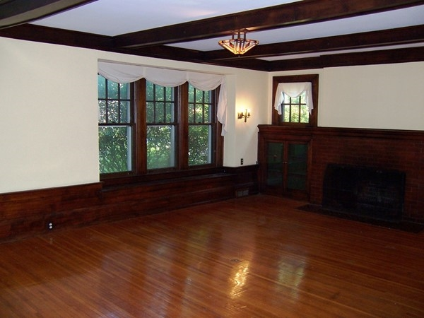 Huge living room with natural woodwork in a large home in the Park Avenue area