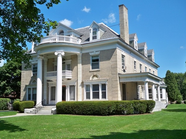 Greek Revival architectural style for this white brick mansion at 1132 East Avenue