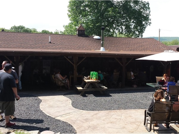 Share picnic area and tables at Haven Road Bashakill Winery with live music.