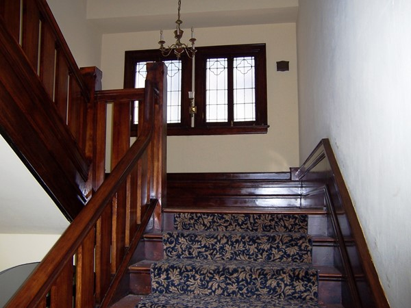 Grand staircase up to a large landing in this Park Avenue home
