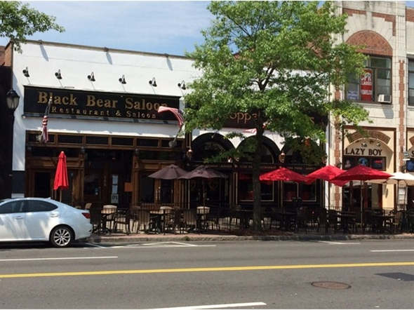 Black Bear Saloon and other shops in White Plains