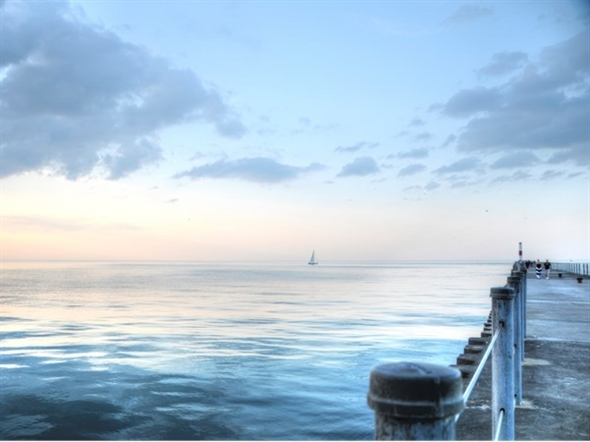 A perfect summer evening is taking a walk on the Charlotte Pier to Lake Ontario