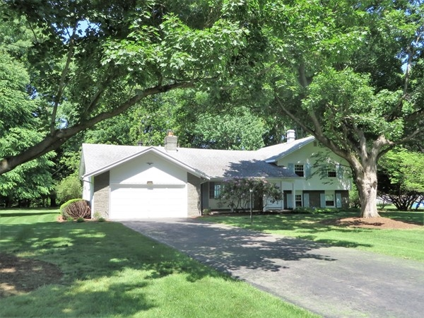 Beautiful home on a two-acre lot backing to a creek on Countryside Road in Perinton