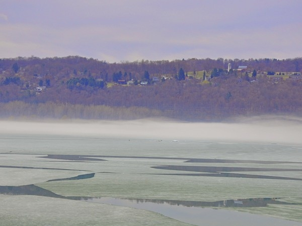 Cayuga Lake thawing out in the beginning of spring.  The ice water is colder than air causing fog