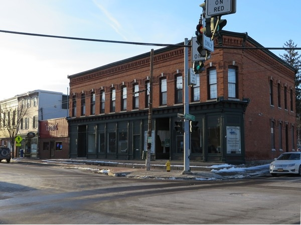 Historic brick building at the four corners in Honeoye Falls on the southwest corner