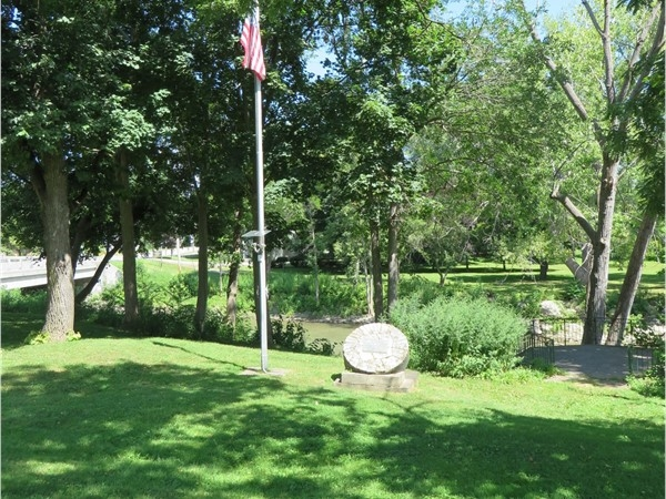 Flagpole and monument for the Veterans Memorial Park in the hamlet of Rush