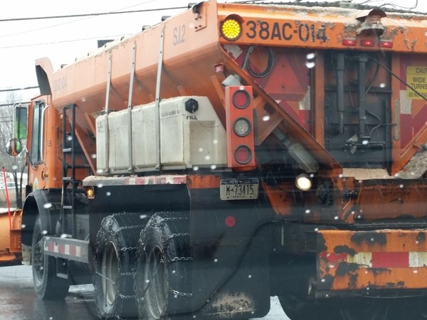 The snow plow truck is ready to clear the roads