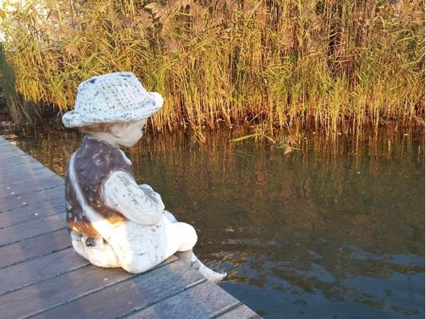 Near Harvest on Fort Pond Restaurant. Montauk. Statue of a girl