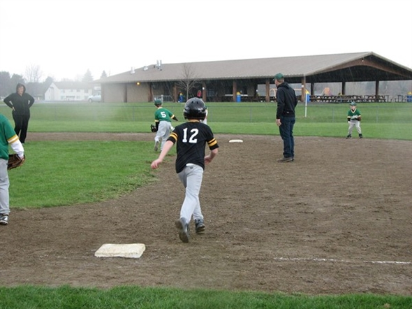 It rained but the action was hot during opening day of Little League Baseball at The Holding Point!