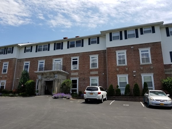 The converted mansion at Plum Point Condominiums
