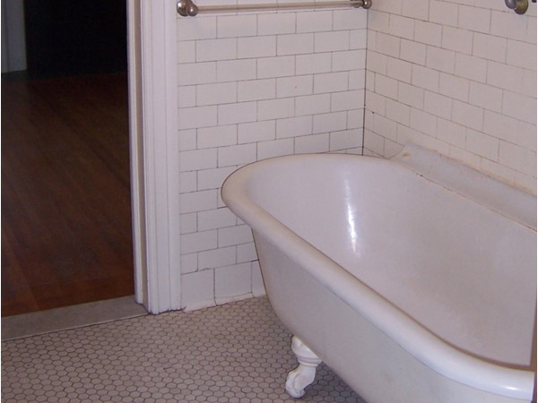 Original classic white bathtub in tis large turn of the century home in the Park Avenue area