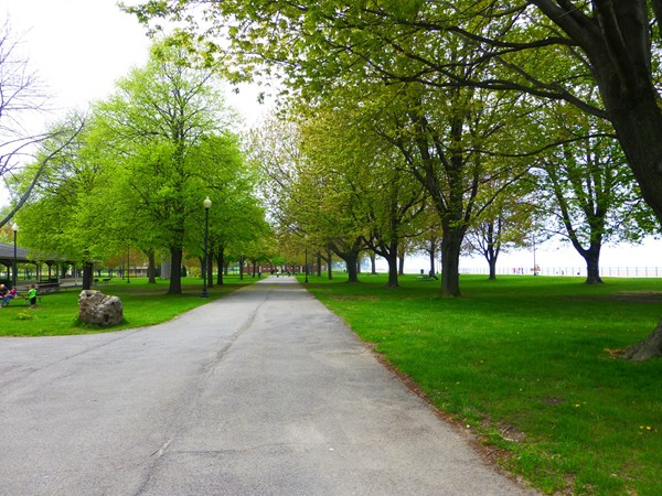 A view down a walkway in the park along the lake.