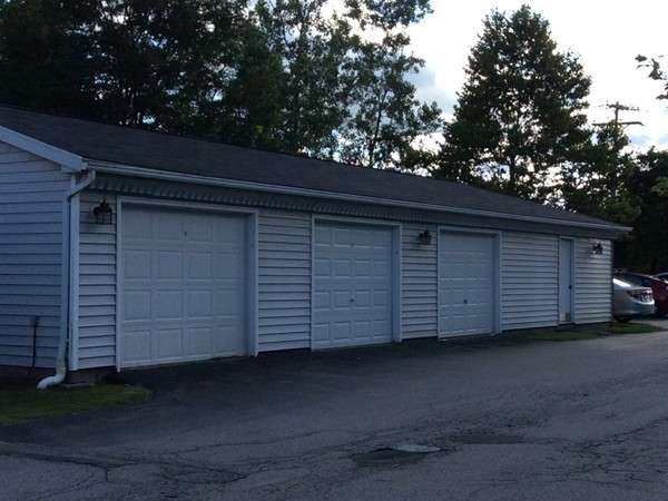 Bank of garages. The last door at the right is the trash and recycling room