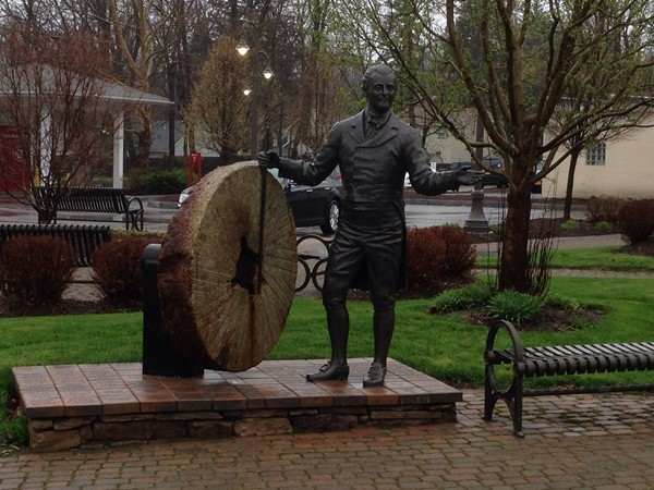 Daniel Penfield, our town's namesake, greets travelers at the iconic Four Corners of Penfield