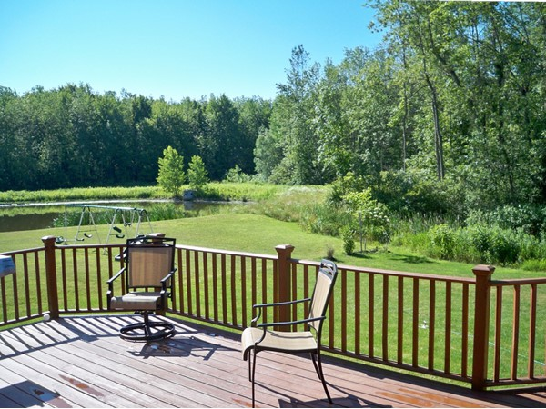 Beautiful pond setting with woods behind in the Park Place subdivision in Chili
