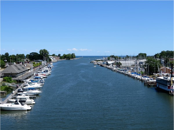 The Yacht Club of Rochester and power boats docked along the Genesee River