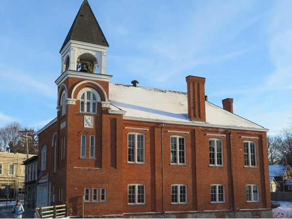 Historic brick Town Hall building on the edge of Honeoye Creek in the Village of Honeoye Falls