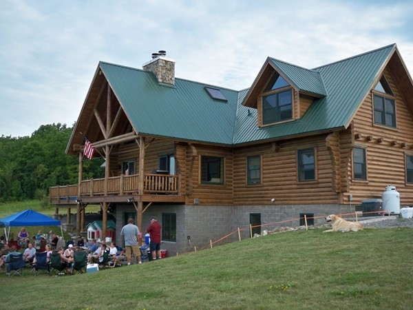 Pig roast event at a log home on 100 acres in Rush