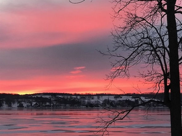 Sunrise over frozen Conesus Lake is a sight to behold. Lakes aren't just for summer
