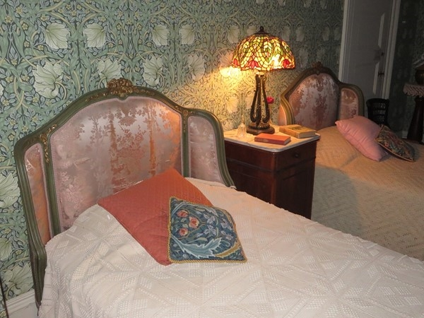 Antique twin head boards in a bedroom at the Sonnenberg Mansion