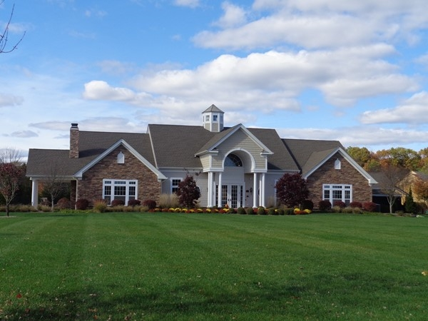 Community clubhouse with fitness center, kitchen/tavern room and heated swimming pool